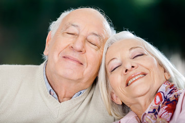 Loving Senior Couple Relaxing With Eyes Closed