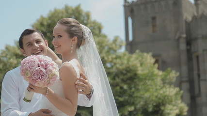 Groom gently tilts the bride and gently kisses her