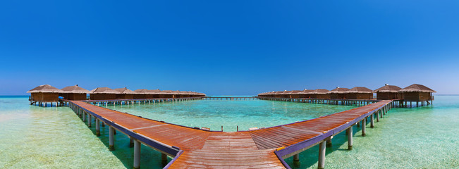 Bungalows on tropical Maldives island