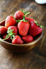 ripe strawberries in rustic bowl