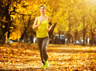 Running woman. Runner is jogging in sunny bright light in the au