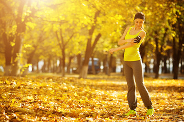 Running woman. Runner is training and listening to music. Female