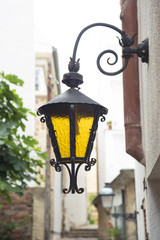 Ancient small lamp on the street. Europe.