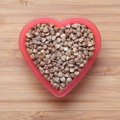 Buckwheat in a heart bowl
