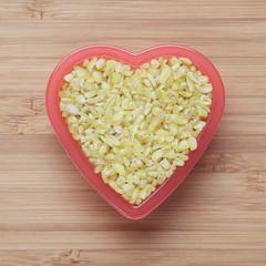 Bulgur wheat in a heart bowl
