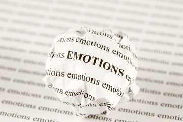 Crumpled paper ball with words emotions