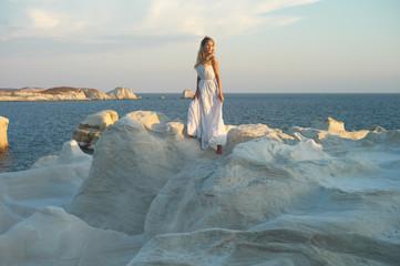 Lady in white dress in an unusual landscape
