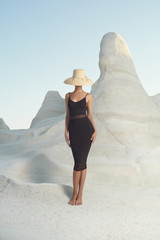 Lady in hat in an unusual landscape