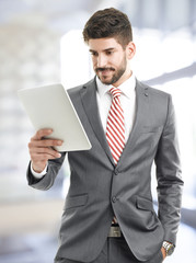 Portrait of young businessman portrait with digital tablet