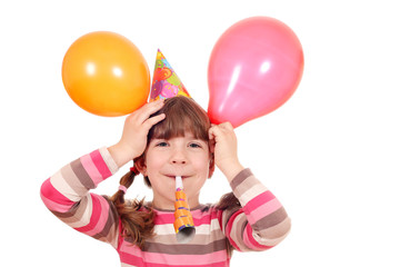 happy little girl with trumpet and balloons birthday party