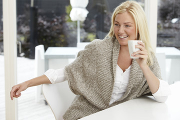 Beautiful woman enjoying coffee at home