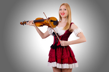 Girl playing violin on white