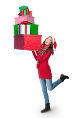 Young woman carrying a pile of presents