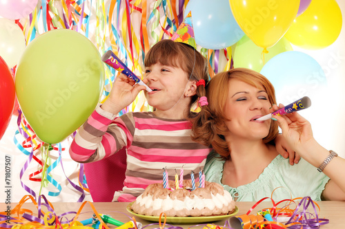 canvas print picture happy daughter and mother with trumpets and balloons on birthday