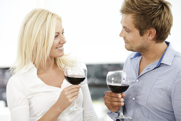 Mid adult couple enjoying red wine