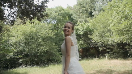 The background behind the bride circling in the park