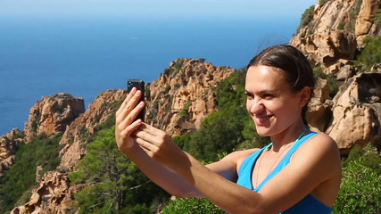 Young woman take a selfie photo by the sea, slow motion