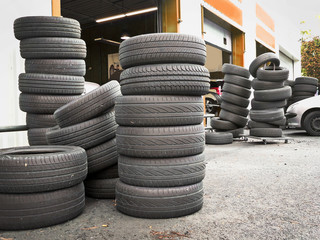 Pile of tires outside a car repair service station