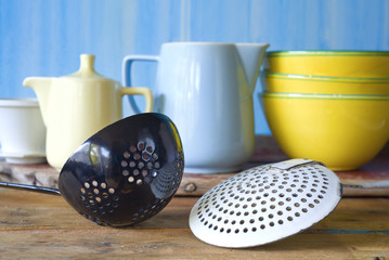 kitchen utensils, old dippers and dishes, selective focus