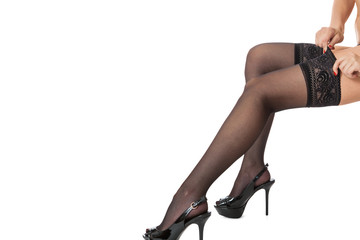 Sexy female legs in stilettos and stockings