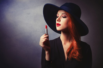 Style redhead women in black wth lipstick on classic background