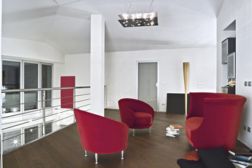 red velvet armchairs in modern living room with parquet floor