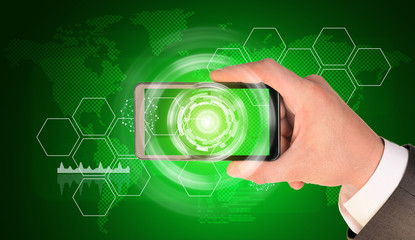 Man hand holding smart phone. Image of business elements on