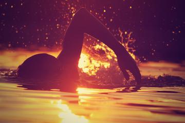 Swimming in sunset/sunrise.