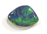 Polished opal from Lightning ridge, Australia. 2cm across.