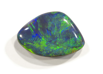 Polished opal from Lightning ridge, Australia. 2cm across.