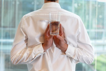 fit business man with glass of water - healhy lifestyle
