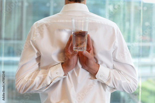 canvas print picture fit business man with glass of water - healhy lifestyle