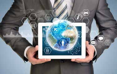 Man hands using tablet pc. Image of Earth and hexagons with