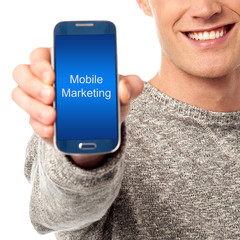 Cropped image of man displaying smart phone