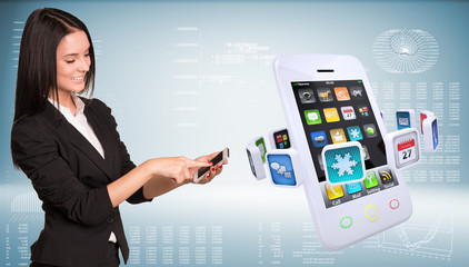 Businesswoman holding smartphone and smiling. Big phone with app