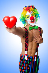 Clown with heart isolated on white