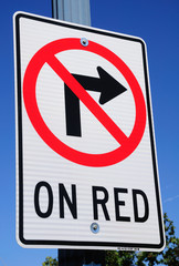 Traffic sign prohibiting right turn on red traffic light.