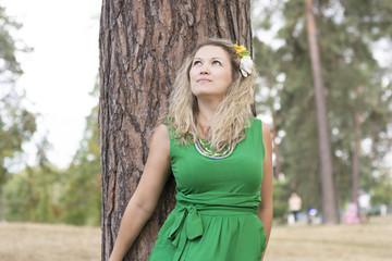 Beautiful smiling woman relaxing outdoor