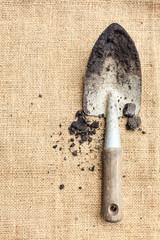 Gardening tools, soil on sack texture