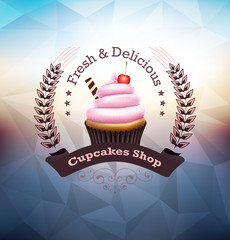 Cupcake with label over polygonal background