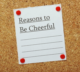Reasons to be Cheerful on a cork notice board