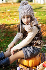 Adorable little girl is wearing winter clothes