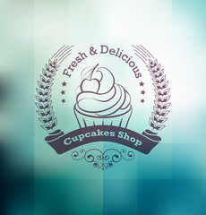 Cupcake food label over blurred geometrical background