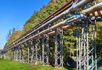 Industrial pipelines construction in green area.