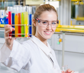young woman in a chemical lab