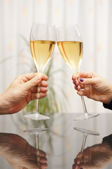 Man and woman celebrating with wine