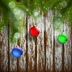 Christmas tree with decoration on a wooden surface