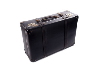 An old black vintage leather suitcase with straps