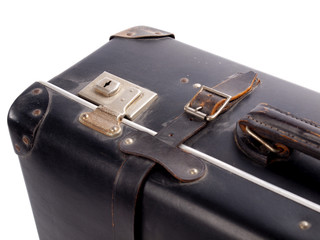 Detail of an old black vintage leather suitcase with straps