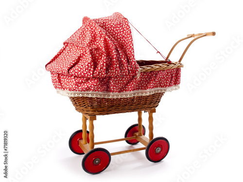 An old vintage childrens doll stroller over a white background Poster